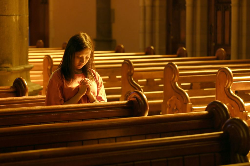 girl in church praying