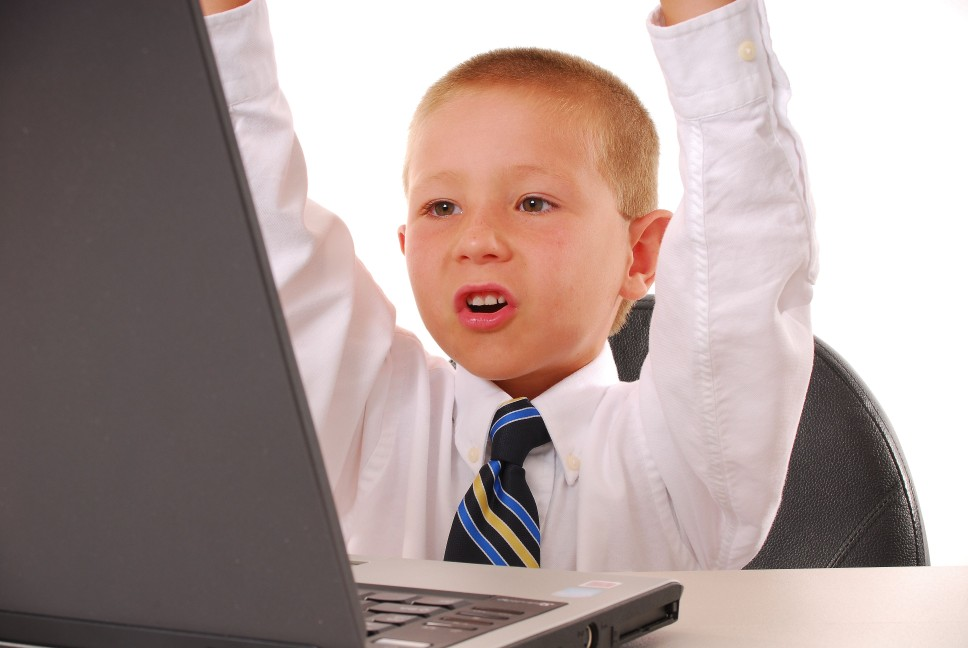 boy at computer triumphant