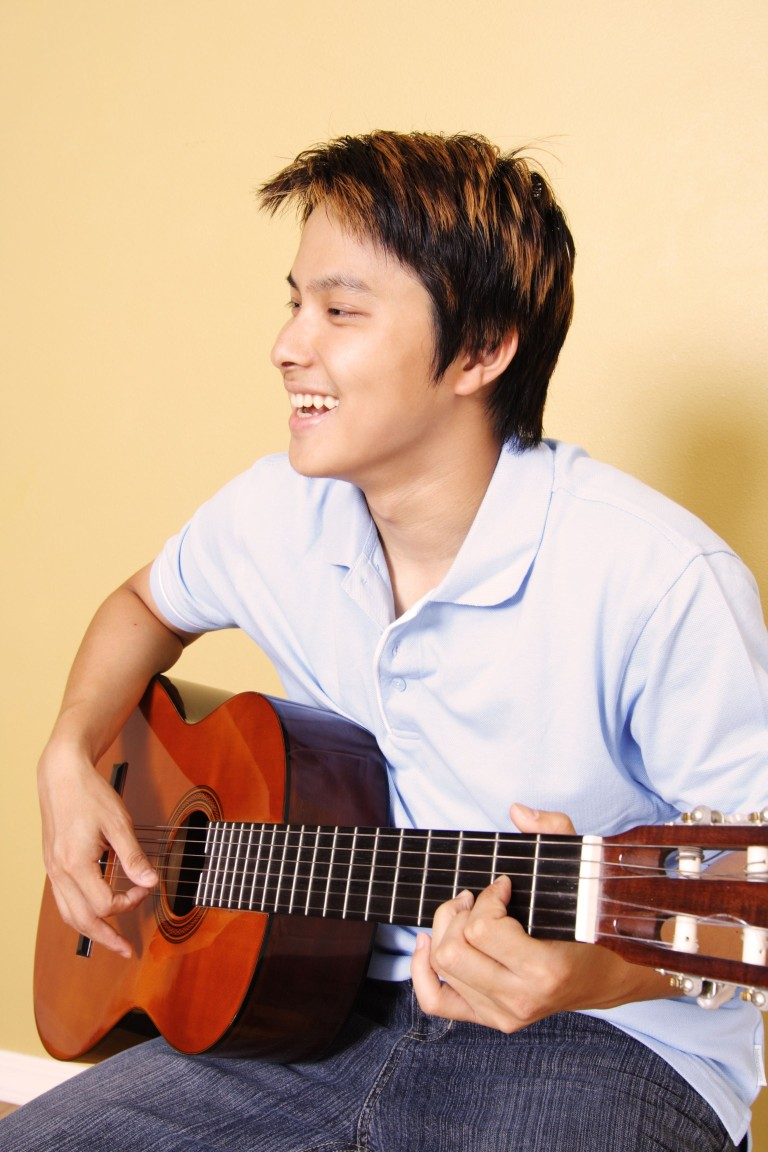 teen with guitar