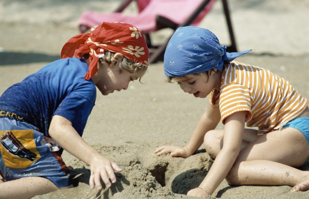 youth playing in the sand