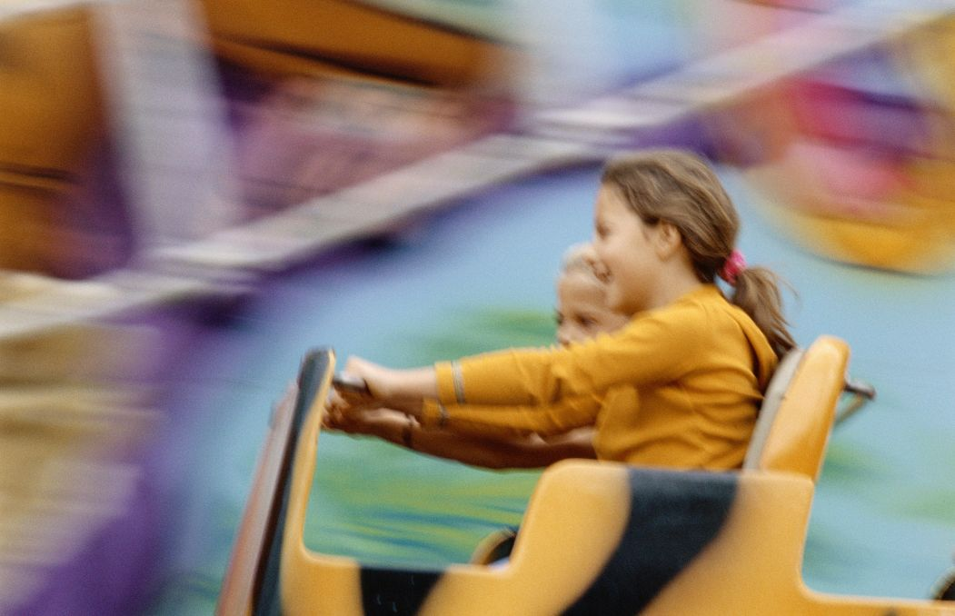 two girls on an amusement park ride