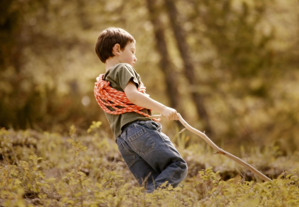 resourceful boy with stick and rope