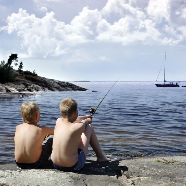 two boys fishing