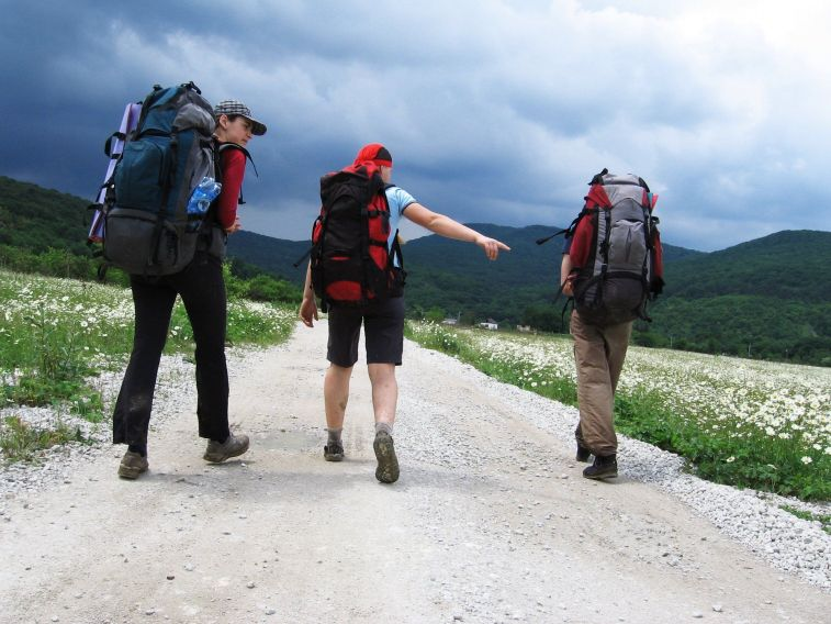 three youth hiking