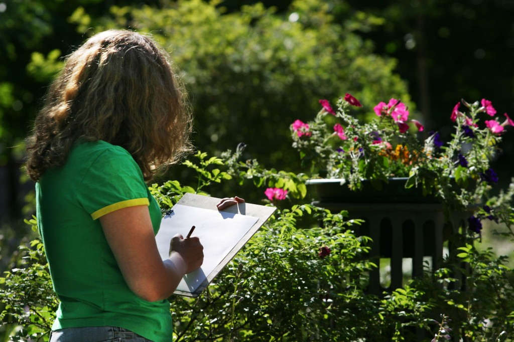 girl outdoors with notebook