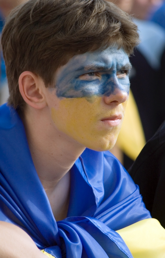 young man with face painted