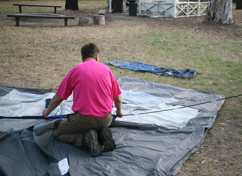 man setting up tent